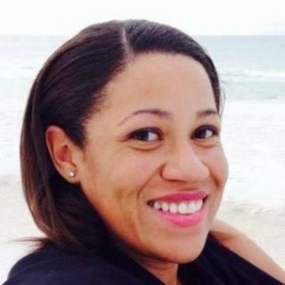Headshot of Deja Cronley on the beach